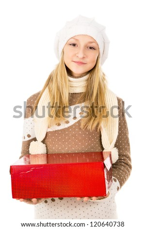 Teen girl in a hat holding a gift isolated on white background - stock photo