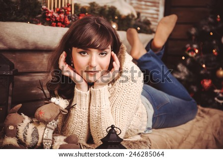 teen girl in a New Year's rustic interior - stock photo