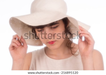 teen girl in in a white dress with a white hat on a white background - stock photo