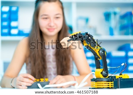 Teen girl in robotics laboratory
