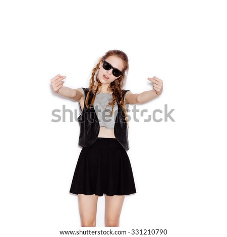 Teen Girl in sunglasses showing middle fingers. Young woman having fun. Not isolated on white background - stock photo