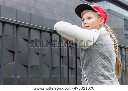 Teen Girl Iooking up against a Wall. Copy Space