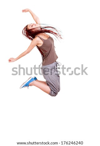 Teen girl jumping for joy on white background - stock photo