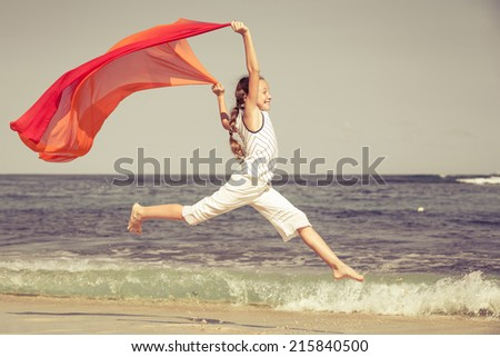 teen girl  jumping on the beach on blue sea shore in summer vacation at the day time - stock photo