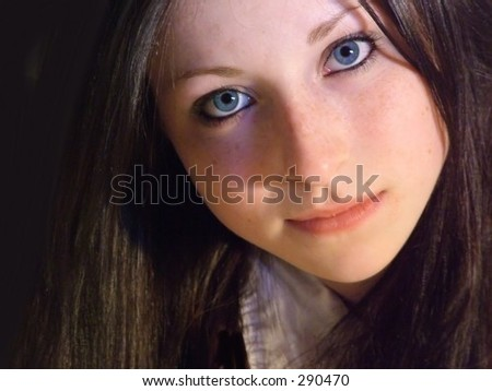 Teen girl looking at you, serious - stock photo