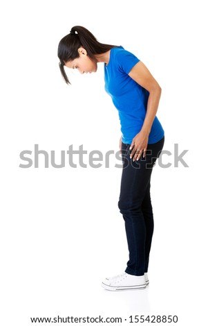 Teen girl looking down. Isolated on white  - stock photo
