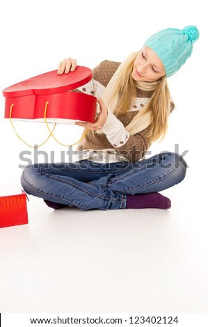 teen girl looking into gift - stock photo