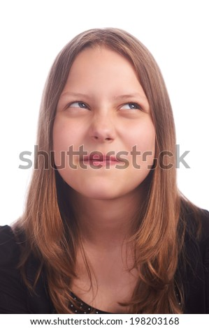 teen girl making funny faces on white background isolated on white, studioshot - stock photo