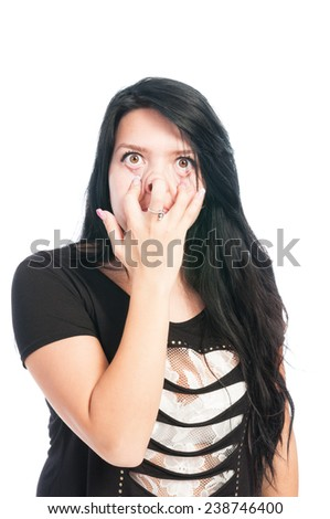 Teen girl making goofy, funny, scarry face isolated on white background - stock photo