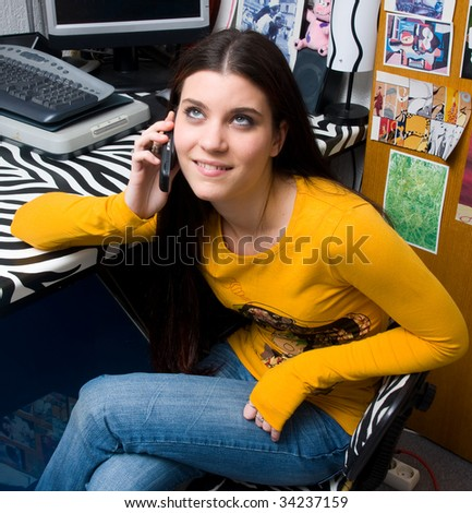 teen girl on phone in her room