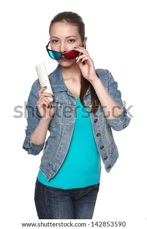 Teen girl peering over the rim of 3D glasses holding a TV remote control, isolated on white - stock photo