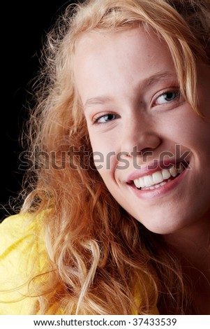Teen girl portrait isolated on black background