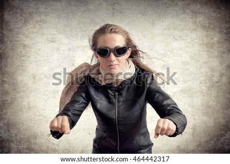 teen girl pretending to ride a motorcycle