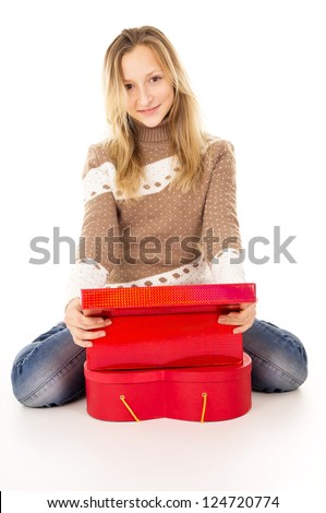 Teen girl sitting near the gift boxes - stock photo