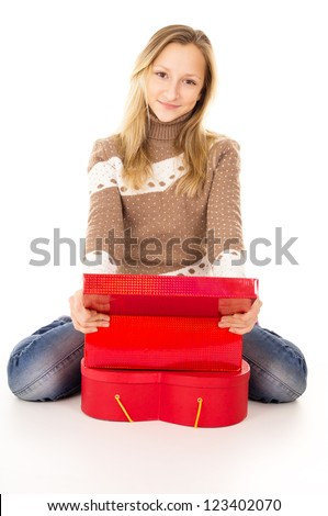 Teen girl sitting near the gift boxes isolated - stock photo