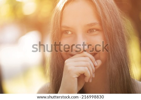 teen girl smiling on outdoor walk, summer time