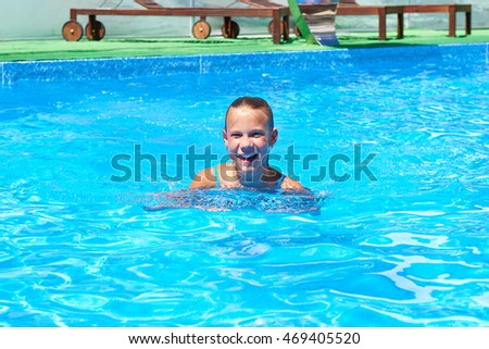 Teen girl swimming in the pool