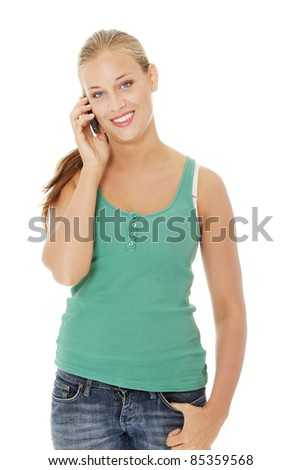 Teen girl using cell phone. Isolated on white background.
