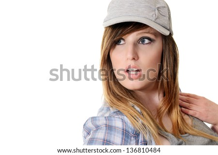 teen girl wearing baseball hat - stock photo