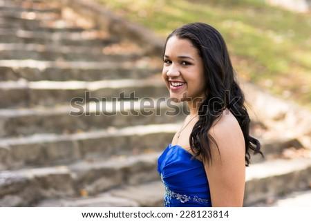 Teen girl wearing her formal Quinceanera dress - stock photo
