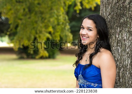 Teen girl wearing her formal Quinceanera dress - stock photo