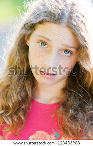 teen girl with a disgruntled looking expression - stock photo