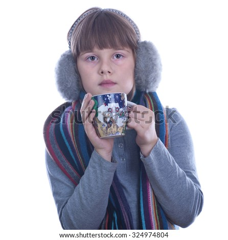 Teen girl with Christmas decorated cup in hands drinks tea isolated white - stock photo