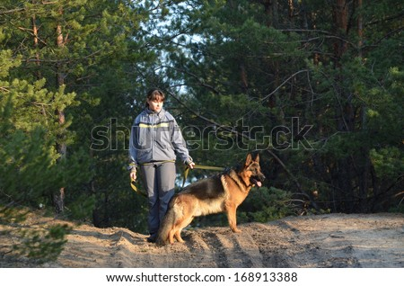 Teen girl with dog.Near Kiev,Ukraine