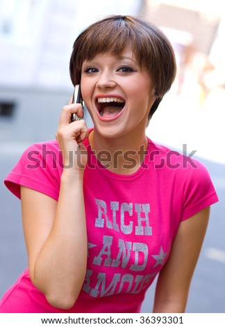teen girl with happy expression talking to mobile phone - stock photo