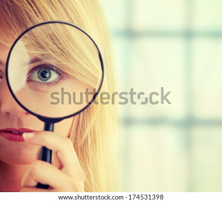 Teen girl with magnifier - stock photo