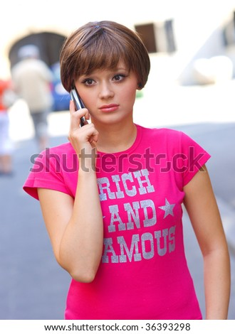 teen girl with worried expression talking to mobile phone