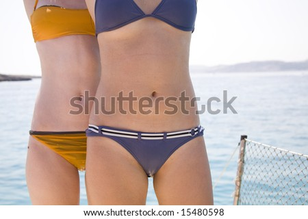 Teen girls in bikini on ship