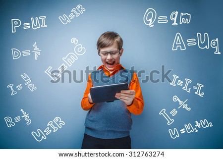 Teen happy happy boy schoolboy student with glasses with the tablet formula physics science scientist studio background infographics - stock photo
