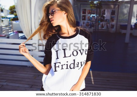 Teen hipster Relaxing after long trip.Student camp,Top view of beautiful young woman in headwear lying on floor holding mobile phone and smiling.Autumn look,warm sweater,volume hairstyle,soft colors - stock photo