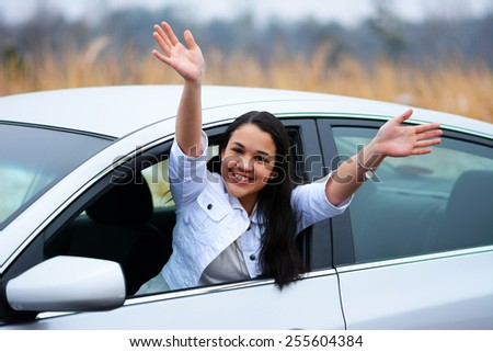 Teen in a car getting ready to drive - stock photo