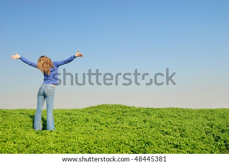 Teen in a wheaten field looks at horizon