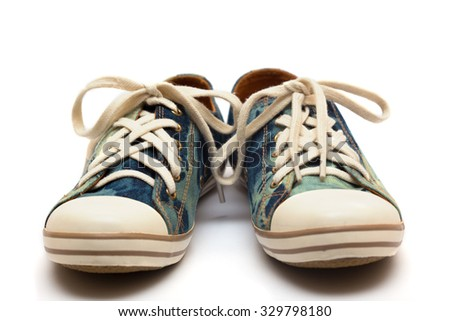 teen jeans sneakers isolated on a white - stock photo