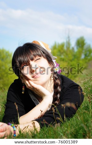 Teen lying on grass thinking