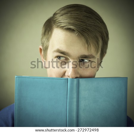 Teen man reading book. Toned photo