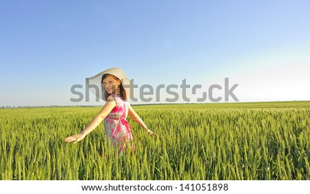 teen on field in summer time - stock photo