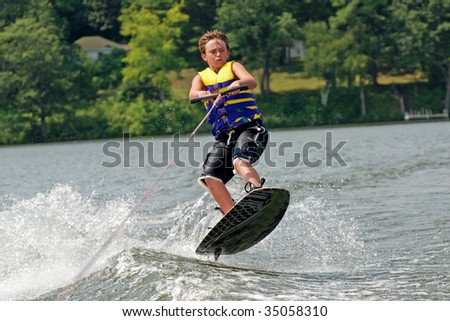 teen on wake-board - stock photo