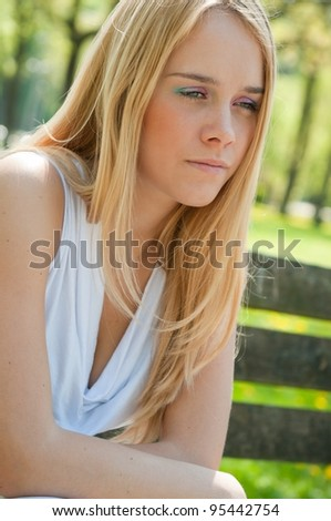 Teen person in depression outdoors - stock photo