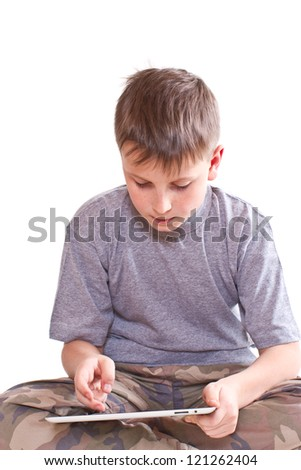 Teen plays on the tablet computer on a white background - stock photo