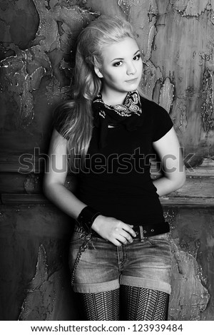 teen punk girl against wall background black and white portrait - stock photo