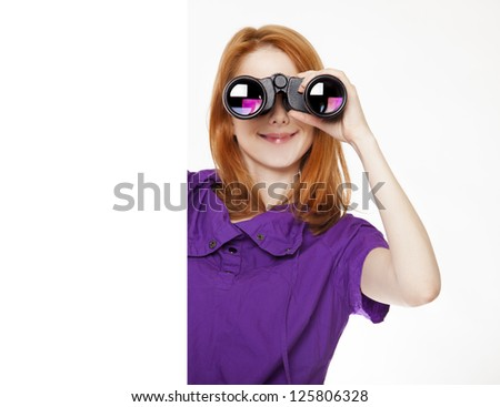 Teen red-haired girl with binoculars isolated on white background