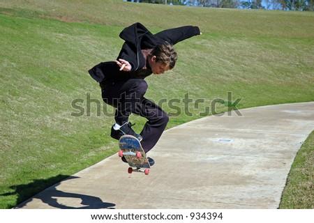 Teen Skateboarder Airborne - stock photo