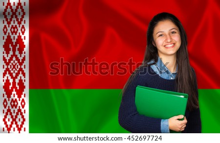 Teen student smiling over Belarusian flag. Concept of lessons and learning of foreign languages.