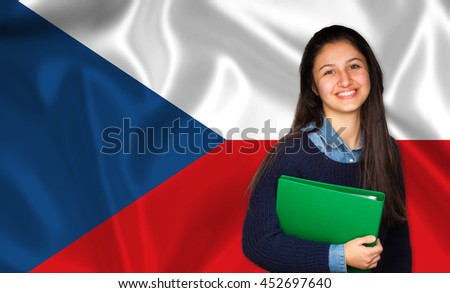 Teen student smiling over Czech flag. Concept of lessons and learning of foreign languages.