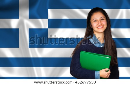 Teen student smiling over Greek flag. Concept of lessons and learning of foreign languages.
