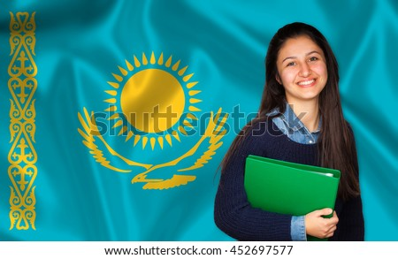 Teen student smiling over Kazakh flag. Concept of lessons and learning of foreign languages.